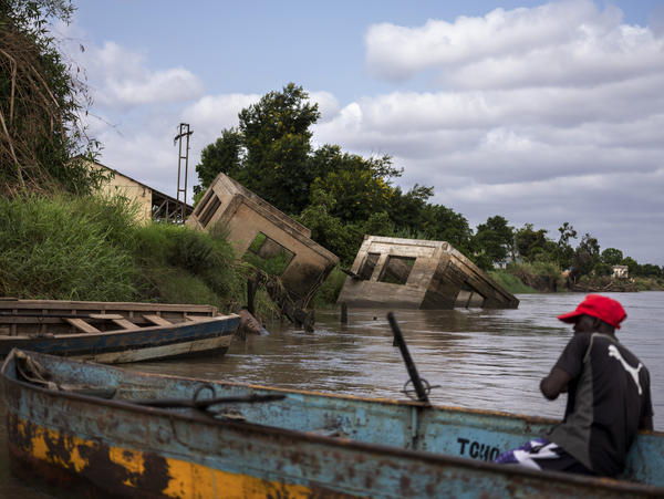 Homes destroyed by Cyclone Idai litter the riverbanks of Buzi district, Mozambique. Weather forecasters there say they do not have all the resources they need to cope with more extreme weather affecting the country as a result of climate change.