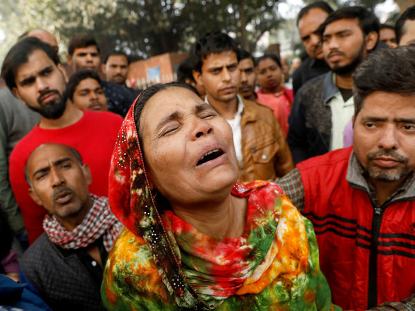 A fire that swept through a factory where laborers were sleeping on Sunday morning, killing at least 43 people. Relatives of the victims gathered outside a hospital mortuary in the city on Sunday.
