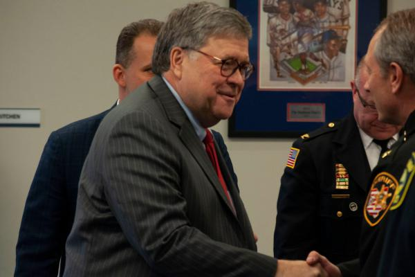 Attorney General William Barr meets with local law enforcement in Cleveland in November, 2019. Barr touted the success of federal-local partnerships in policing and hinted at more federal funding for departments.