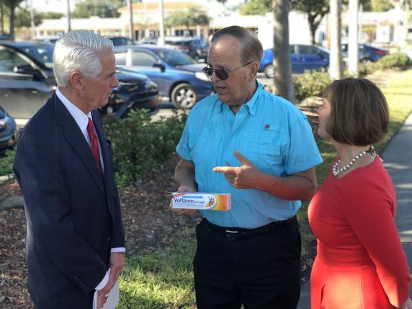 U.S. Representatives Charie Crist and Kathy Castor meet with veteran Bill Hodges to talk about expensive prescription drugs.
