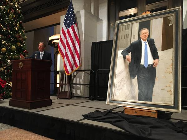 Former Gov. John Kasich talks to the audience assembled for the unveiling of his official portrait at the Statehouse.