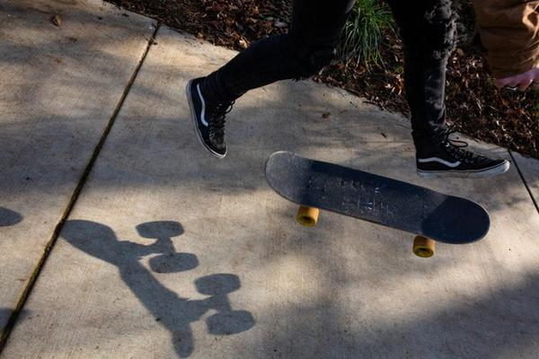 Caleb skates through a public park Monday, Nov. 11, 2019, in Oregon. He likes living in a small town, he said, because he gets around mostly on foot and by skateboard.