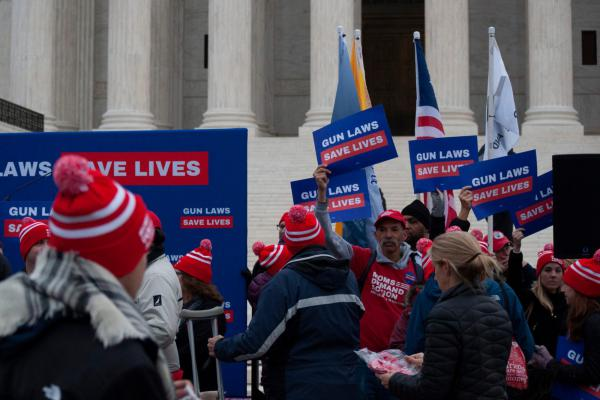 Protesters rally outside the U.S. Supreme Court as the court hears arguments in a Second Amendment case on Dec. 2, 2019.