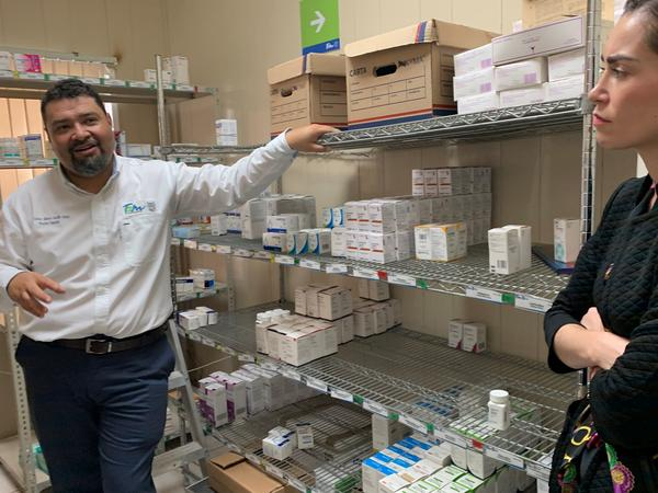 Dr. Carrillo shows members of a health delegation one of the stock rooms where medication is stored.