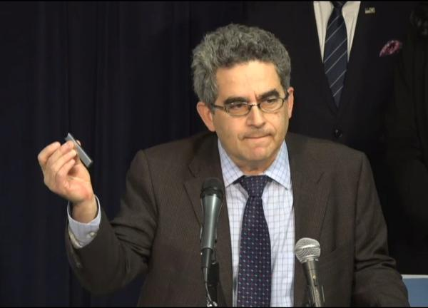 Dr. Johnathan Klein holds up a JUUL pod at a news conference in Chicago on Dec. 12
