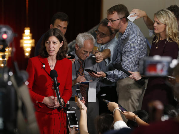 Rep. Elaine Luria answers reporters' questions prior to a town hall at a church in Virginia Beach, Va., in October.