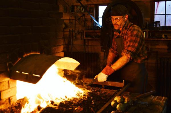 Joel Sanderson does metalwork out of his blacksmith shop near Quincy, Michigan.
