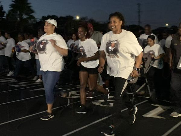 Evelyn Brady (right) leads a run to honor her son, Mohammed Haitham, who was killed in a mass shooting at the Pensacola Naval Base. Kerry Sheridan/WUSF