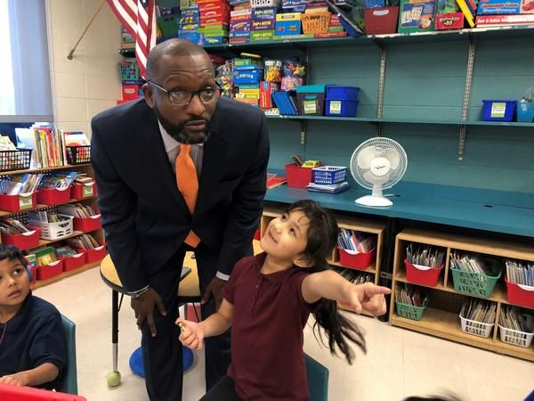 Kansas City Public Schools Superintendent Mark Bedell visits students at J.A. Rogers Elementary. Students at the school who have perfect attendance at the school are entered into a drawing for a bike each month.