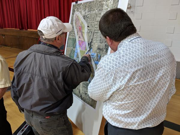 A KDHE employee explains a map of a plume of toxic dry cleaning chemicals in December 2017.
