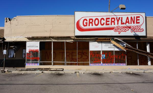 Grocery Lane was the place for healthy, affordable food in Old North Dayton before the tornado. Six months after the storm, it remains boarded up.