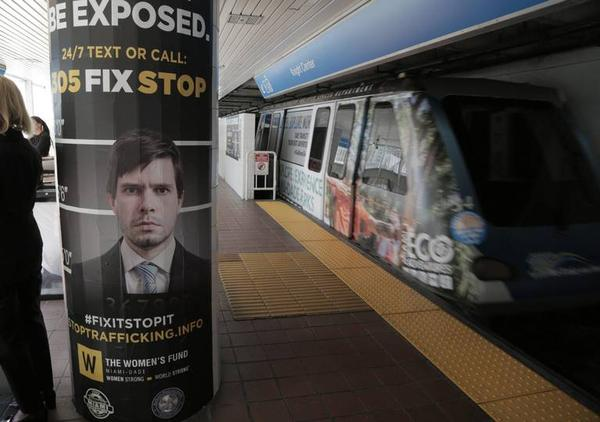 Super Bowl sex trafficking awareness campaign signs at the Metromover Knight Center Station Platform, 100 SE Second St. in Miami.