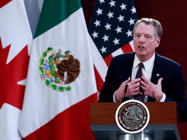 U.S. Trade Representative Robert Lighthizer speaks Dec. 10 in Mexico City during an event to sign an updated trade agreement between the U.S., Canada and Mexico. It was just one development in a week that exposed deep cracks in the global trading system.