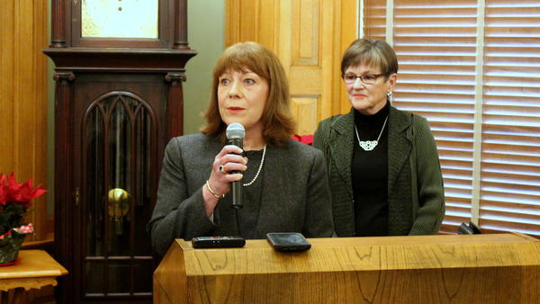 Judge Evelyn Wilson (front) and Gov. Laura Kelly at Monday's announcement.