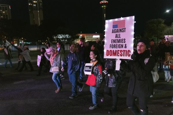 Rally-goers marched in downtown San Antonio the day before the U.S. House votes on President Trump's impeachment.