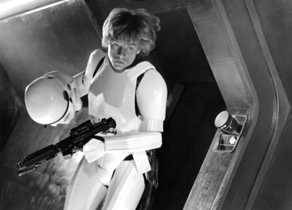 Mark Hamill takes off his storm trooper helmet in a scene from the film <em>Star Wars</em>.
