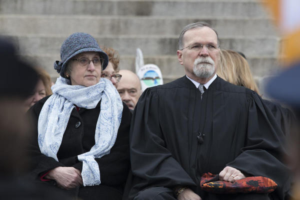 Retiring Chief Justice Lawton Nuss attends Gov. Laura Kelly's inauguration in January. He's stepping down this week after almost 20 years on the Kansas Supreme Court.