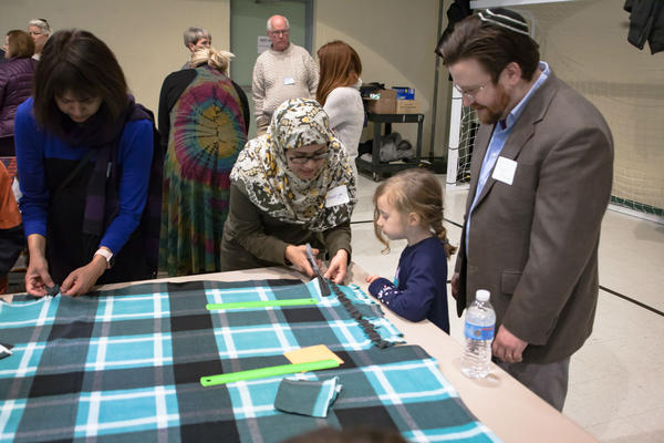 Volunteers make no-sew blankets during the annual Jewish and Muslim Day of Community Service in 2017.