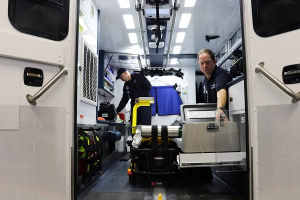 Paramedics Scott Widener (left) and Mike Warnimont (right) prepare the mobile stroke unit for the day.