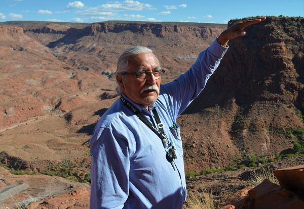 Willie Grayeyes stands at the edge of a canyon outside of the Navajo Mountain community.