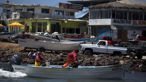 Fishermen and visitors gather at the beach in the village of Popotla, Mexico, some 15 miles south of the U.S.-Mexico border, in July 2010. Illegal immigrants are increasingly looking to the ocean, as they consider crossing overland more risky.