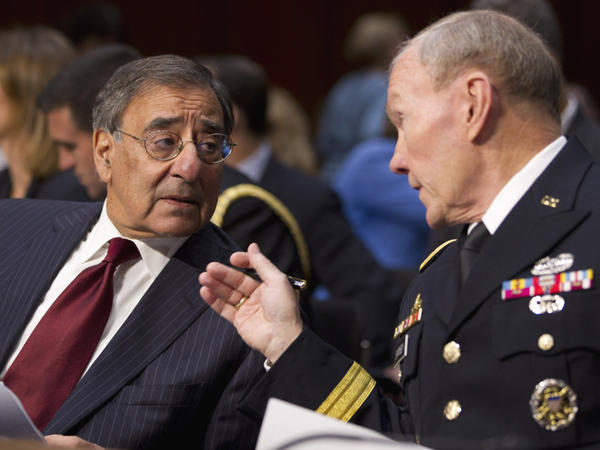 Defense Secretary Leon Panetta (left) talks with Gen. Martin Dempsey, chairman of the Joint Chiefs of Staff, in Washington on Tuesday. The pair testified before the Senate Armed Services Committee hearing on security issues relating to Iraq.