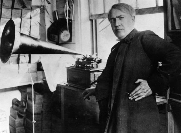 <b>Thomas Alva Edison: </b> Transformed American industry and culture by inventing the phonograph and the motion picture camera and developing a long-lasting electric light bulb. Known as the Wizard of Menlo Park, Edison also founded General Electric. In this photo from 1877, Edison stands with the phonograph.