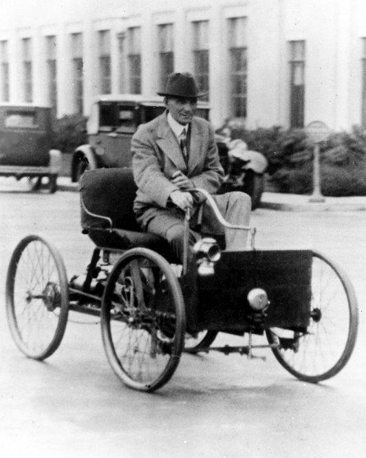 <b>Henry Ford: </b> Brought automobiles to the masses through his Ford Motor Co. and pioneered the use of assembly-line manufacturing. In this 1927 photo, Ford drives his company's first vehicle, the Quadricycle.