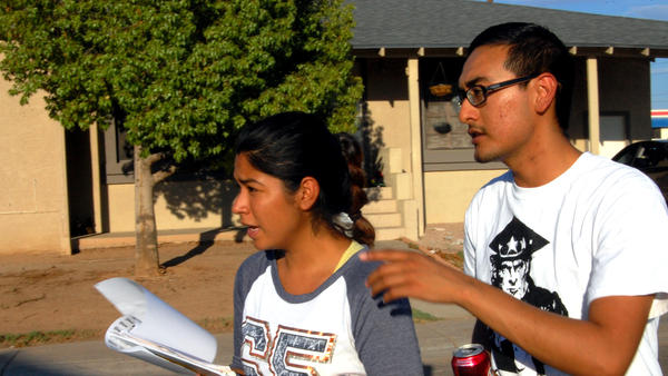 """Maxima Guerrero and Daniel Rodriguez canvass for votes in Phoenix. Rodriguez moved to the U.S. with his mother when he was a child, and is undocumented. """"The best thing I can do now,"""" he says, """"is organize those that can [vote], and make them vote for me."""""""