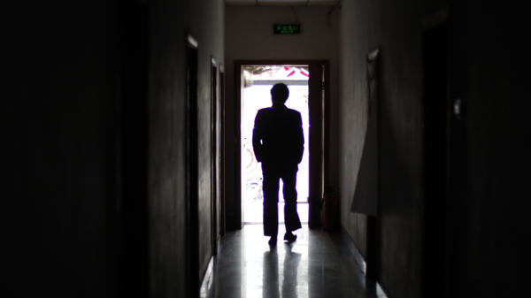 """A man walks through a former unofficial, or """"black,"""" jail in Beijing, in 2009. It's estimated that thousands of Chinese lodging protests against the government are illegally detained in secret sites such as this one, even though the government says they don't exist."""