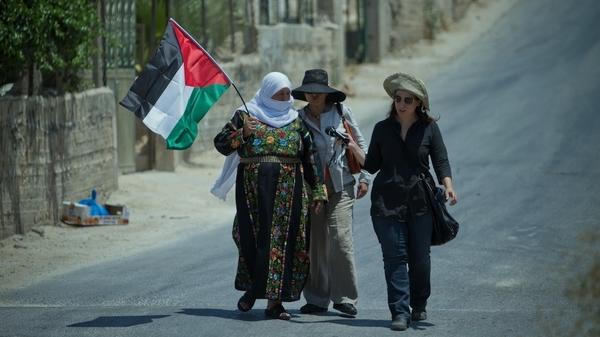 NPR correspondent Lourdes Garcia-Navarro (right) conducts an interview in the West Bank.