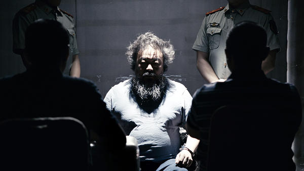 The video for Chinese artist Ai Weiwei's newly released song starts by re-creating the conditions of his captivity during the 81 days he was held in police detention in 2011, and later dissolves into a dystopian nightmare.