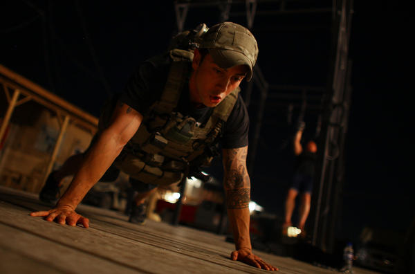 U.S. Army Sgt. Michael Johnson trains at Bagram Air Field for the Memorial Day Murphy, a CrossFit workout honoring a Navy SEAL killed in Afghanistan in 2005.