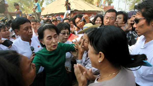 Myanmar opposition leader Aung San Suu Kyi has been under fire for working with the government on a number of issues. Here, she meets in March with protesters who oppose a copper mine backed by Chinese investors. She supports the mining project.