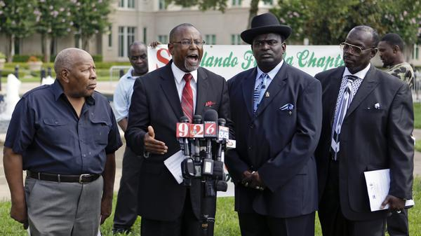 Members of the Southern Christian Leadership Conference (from left: the Rev. Levy Wilcox, the Rev. R.L. Gundy, the Rev. Jake Stovall, and Jerry West)  appeal for calm in Sanford, Fla., before a verdict in the Zimmerman trial.
