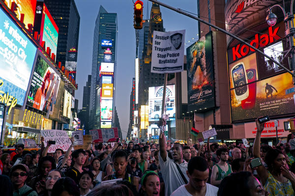 Marchers in New York's Times Square Sunday protest the acquittal of George Zimmerman in the killing of 17-year-old Trayvon Martin in Sanford, Fla.