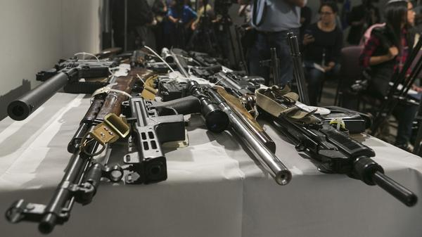 Firearms seized during a sweep by the Los Angeles Police Department using the California's Armed Prohibited Persons System initiative. The program uses a database to identify gun owners who are no longer allowed to possess a firearm.