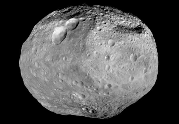 This mosaic image from NASA's Dawn spacecraft, captured between 2011 to 2012, shows the giant asteroid Vesta. The mountain at the south pole, seen at the bottom of the image, is more than twice the height of Mount Everest.