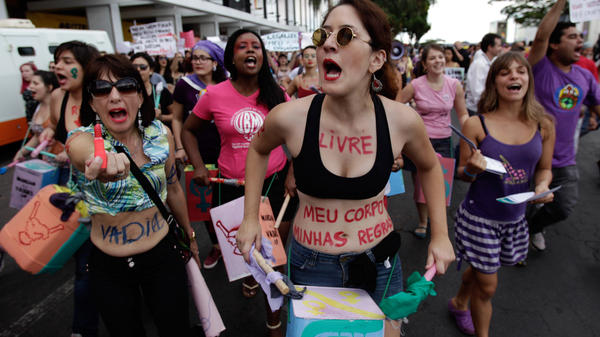 """Demonstrators rally to protest sexism in Brasilia, Brazil, last June. <a href=""""http://tinyurl.com/m98nbb8"""">A new protest erupted</a> last week after <a href=""""http://tinyurl.com/kynr8dx"""">a study released</a> by Brazil's Institute for Applied Economic Research reported 65 percent of Brazilians believe women who dress provocatively deserve to be attacked."""
