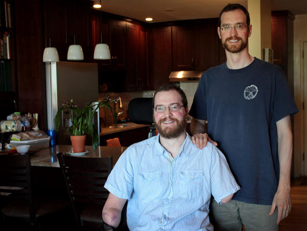 Will Lautzenheiser and his identical twin Tom are pictured at Will's home in Brookline, Mass. on July 3, 2014. (Samantha Fields/Here & Now)