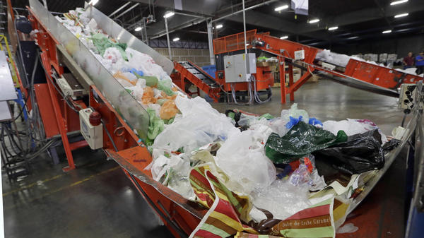 California Gov. Jerry Brown has signed the nation's first statewide ban on single-use plastic bags. Here, mixed plastic items are seen at a recycling plant in Vernon, Calif., earlier this year.