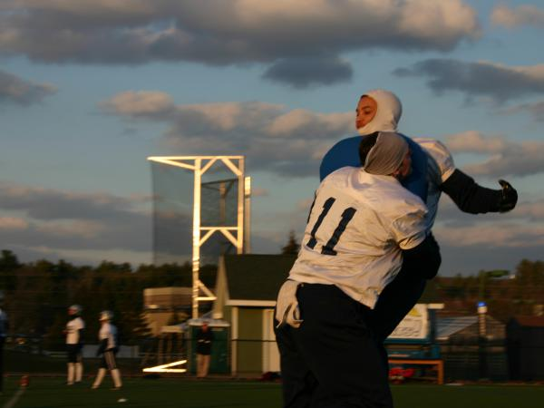Making and taking a hit chest to chest, instead of skull to skull, is easier to remember if you're not wearing a helmet, say University of New Hampshire Wildcat football players.