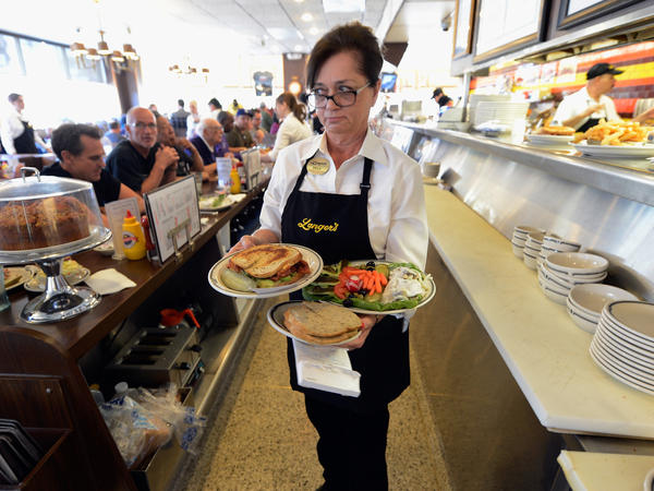 Sheila Abramson serves customers of Langer's Delicatessen in Los Angeles in 2013.