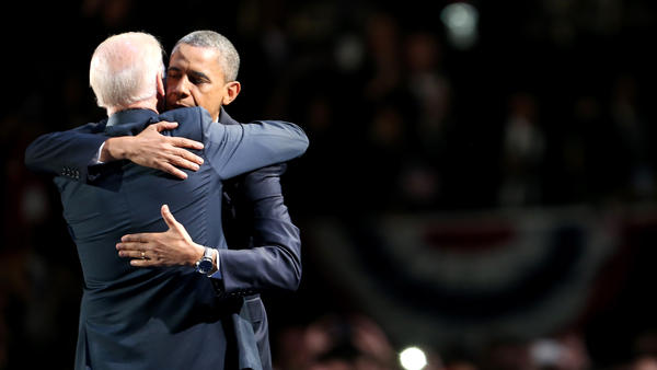 Barack Obama and Joe Biden embrace on stage after his victory speech on election night in 2012.