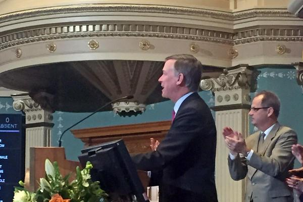 Gov. John Hickenlooper giving his State of the State address from the podium in House of Representatives at the state capitol, Jan. 14, 2016.