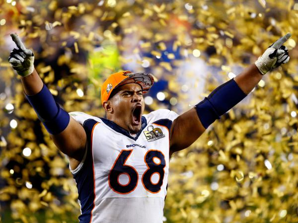 Ryan Harris of the Denver Broncos celebrates after defeating the Carolina Panthers on Sunday. The Broncos beat the Panthers 24-10.