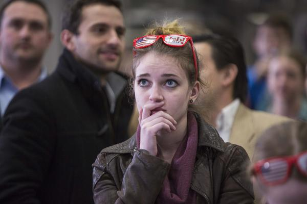A young woman watches poll numbers at Republican presidential candidate Jeb Bush's election-night party on Feb. 9 in Manchester, N.H. In the last presidential election, millenials had the lowest<em> </em>voter turnout of any age group.