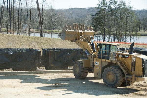 Coal ash is loaded onto rail cars in January at the Dan River plant in Eden, N.C.