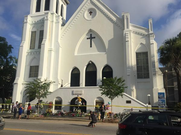 Mourners left flowers and other mementos in front of Charleston's Emanuel African Methodist Episcopal Church in the days following the June 17, 2015, mass shooting. Nine worshippers were gunned down during Bible study in what authorities say was a racially motivated attack on the historic black church.