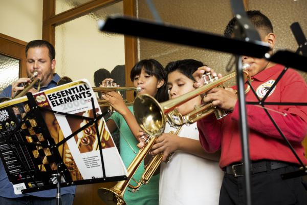 These students attend classes at Harmony Project's headquarters in Hollywood, Calif. The walls are thin; a few of the windows barely close. At 5 o'clock, staffers simply surrender their offices to the kids and their teachers. Forrest Powell, left, and his trumpet students are packed shoulder-to-shoulder in one office-turned-practice room.